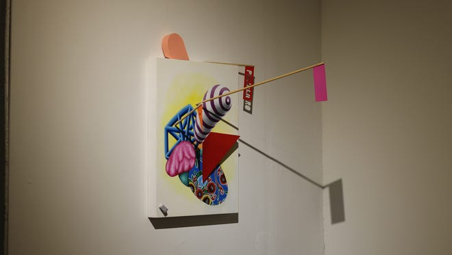 A photograph of artist Aaron Kagan Putt's piece at the exhibit.