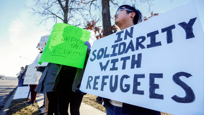 Jan 30, 2017; Springfield, MO, USA; Andy Sun, of Springfield, along with other protestors stands outside of Sen. Roy Blunt's Springfield office on Sunshine Street to protest Blunt's support of President Donald Trump's recent executive order on immigration. Mandatory Credit: Andrew Jansen/News-Leader via USA TODAY NETWORK ORIG FILE ID:  20170130_ajw_usa_088.jpg
