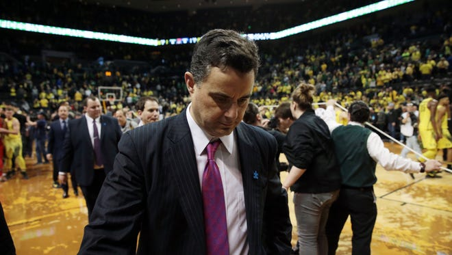 Arizona Wildcats head coach Sean Miller walks off the court against the Oregon Ducks at Matthew Knight Arena.