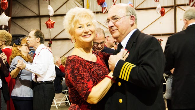A couple dances cheek-to-cheek at last year's USO dance.  CONTRIBUTED PHOTOS  A view from the hangar at the Anderson Regional Airport during last year's GAMAC USO Sweetheart's Dance.  There are many dance lovers ready to cut a rug at this year's USO dance.