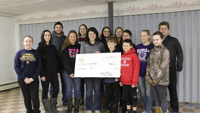 The Wisconsin Farm to Table organization donated proceeds from their 2016 event to the Busy Beavers 4-H Club of Belleville.