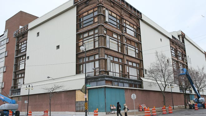 The former Schuster's department store on N. King Drive would be converted into apartments and retail space under preliminary plans. This 2015 photo shows the temporary removal of the building's metal-clad siding to inspect the building's brick exterior.