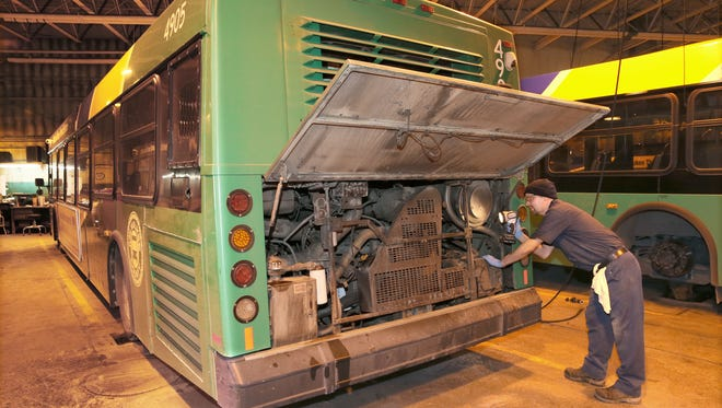 Louis Kwasny Jr., a mechanic with the Milwaukee County Transit System, finishes up a maintenance session on Bus 4905. It has 695,000 miles on it and is 14 years old. He was working at the system's shop at 1718 S. Kinnickinnic Ave.