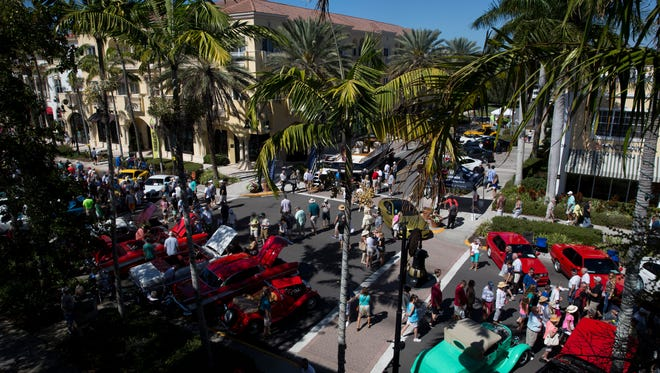 Thousands of enthusiasts and collectors peruse the hundreds of cars on display along Fifth Avenue South during the 'Cars on Fifth' car show Saturday, Feb. 11, 2017 in downtown Naples. The Naples Chapter of the Ferrari Club of America hosted the event. Proceeds will benefit the St. Matthews House.