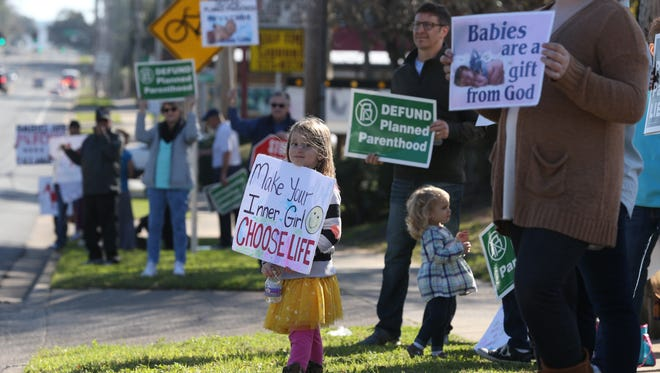 Dozens of anti-abortion protestors rally outside of Planned Parenthood calling for the government to strip federal funding of the institution Saturday, Feb. 11, 2017.The gathering was in coordination with a nationwide effort on the day, rallying for the defunding initiative.