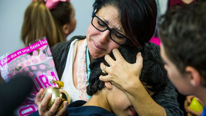 Maria LaRocco emotionally embraces her students after she is awarded a Golden Apple at Sabal Palm Elementary School on Tuesday, Feb. 14, 2017. Every year Champions for Learning gives out the awards for best teaching practices.