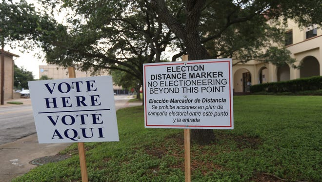 Signs direct voters to where they can cast their ballots in the May 2016 election.
