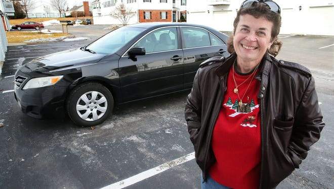 Dawn Bacon-Johnson, a disabled former police officer, had her SUV repossessed. An anonymous couple responded to a church's plea and gave her a Toyota Camry, shown here at her Grafton apartment.