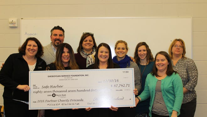The Sheboygan Service Club presents a check to Safe Harbor. Pictured, from left to right: Deborah Lee, Charles Renzelmann, Amee Salzwedel, Laura Roenitz, Andrea Igowsky (SSC), Jaime Marchi (SSC), Andrea Gutschow (SSC), and Mary Lovelien (SSC).