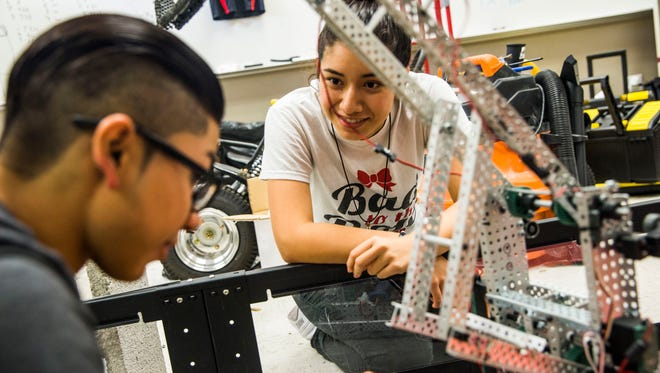 Immokalee High School Robotics Team seniors Kristian Trevino, left, and Jenni Villa prepare their robots for Friday's state robotics competition on Wednesday, Feb. 15, 2017. The VEX Robotics Competition takes place Friday in Tampa.
