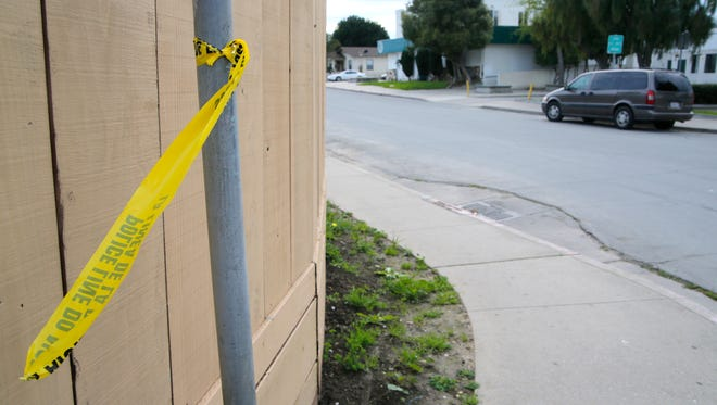 Police tape remains at the corner of North Hebbron Avenue and Elton Place where John Rodzach was shot and killed on Feb. 12.