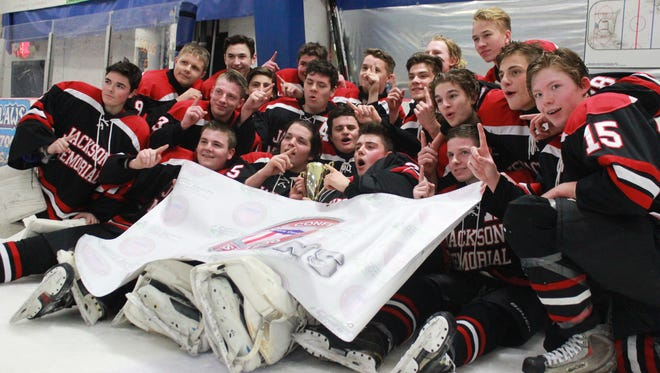 Jackson Memorial celebrates its Handchen Cup victory over Southern Regional on Thursday.