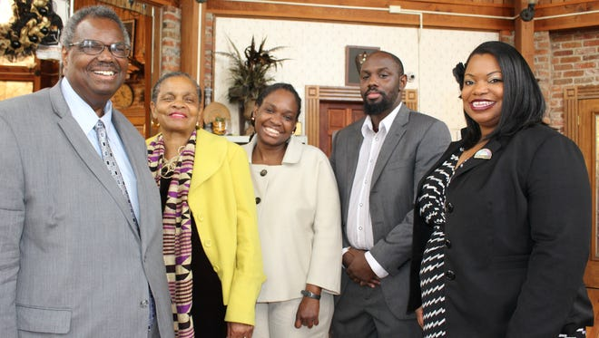 State Sen. Hank Sanders, left, with his wife Faya Toure, Malika Sanders Fortier, Kindaka Sanders and Ainka Sanders Jackson at their Selma law office.