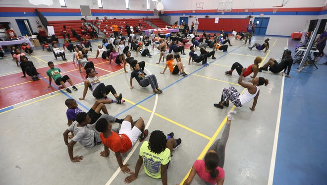 People workout during the 'Family Fitness Day' at the Walker-Ford Community Center on Saturday. The event, which included health screenings, food sampling and aerobics class, was sponsored by the Tallahassee Alumnae and Kappa Epsilon, Chapters of Delta Sigma Theta Sorority, and the Chi Omega Chapter of Omega Psi Phi Fraternity.