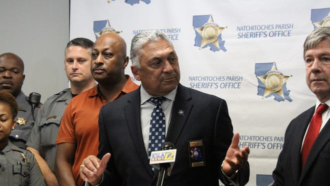 Natchitoches Parish Sheriff Victor Jones Jr. (center) announced Thursday he will not seek re-election this year. He plans to retire when his term ends in 2020.