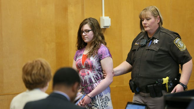 Anissa Weier, one of two girls charged in the Slender Man attempted homicide case, is led into court Monday.