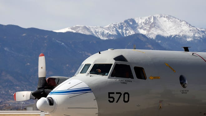 This Feb. 17, 2017, photo shows a Navy P-3 Orion aircraft used for a NASA-led experiment called SnowEx, on an airfield at Peterson Air Force Base in Colorado Springs, Colo. Instrument-laden aircraft are surveying the Colorado high country this month as scientists search for better ways to measure how much water is locked up in the world's mountain snows - water that sustains a substantial share of the global population. (AP Photo/Brennan Linsley)