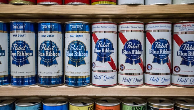 Pabst Blue Ribbon half quart cans, from the collection of BCCA, Breweriana Collectors Club of America member Gene Judd, October 14th, 2015. Judd is the owner of Bone Dry Roofing, and began collecting soda cans as a young man, before he could afford to collect beer cans.