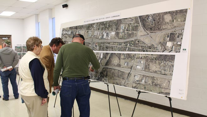 Members of the public study an aerial photograph of U.S. 30 between Ohio 13 and Ohio 45 during a public meeting at the United Steelworkers Union Hall on Wednesday, Feb. 22, 2017. The Ohio Department of Transportation hosted the meeting to gather input on its project to rebuild a section of U.S. 30.