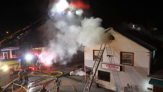 Carmel firefighters battle a fire that broke out in an apartment above Lorenzo's Pizzeria on Fair Street in Carmel on Feb. 22, 2017. Firefighters from Lake Carmel, Mahopac and Putnam Valley assisted Carmel at the scene.