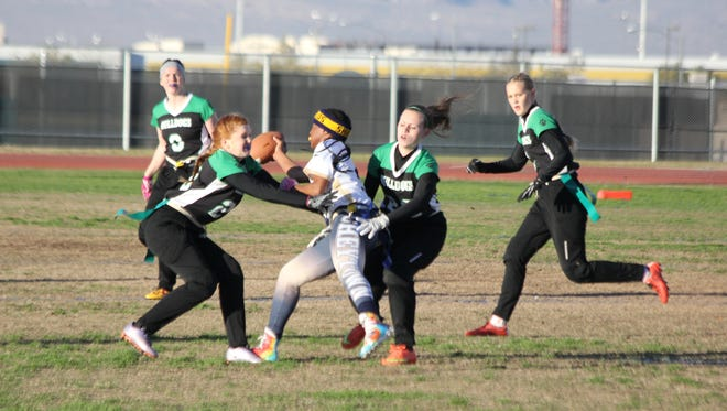 Virgin Valley's Makenzie Leishman, left, and Hanna Haviland converge to stop a Cheyenne ball carrier Thursday in Las Vegas.