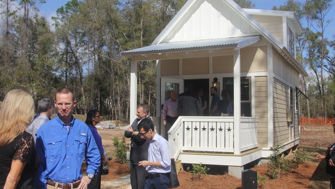 City Commissioners and officials were given a tour of the first house within The Dwellings, a tiny house community built by Tallahassee businessman Rick Kearney.