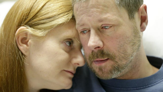 Jason Garcia, 42, sits teary-eyed on Thursday with his wife, Heather, in his hospital bed at Milwaukee's Froedtert Hospital. Garcia, the father of an 8-year-old girl, is living with pulmonary atresia with ventricular septal defect. He has a year at most to live, and he would need a heart, lung and kidney transplant to survive.