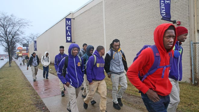 The Milwaukee Collegiate Academy basketball team walks about a mile away to the Business and Economics Academy in Milwaukee to use the gym as they don't have one.