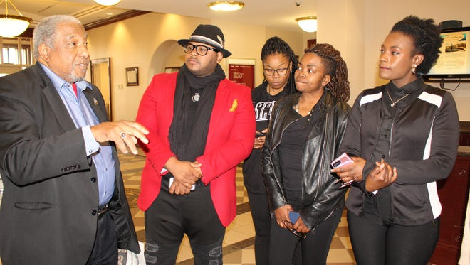 Civil rights leader Bernard Lafayette, left, chats with several who attended the education summit at the Bridge Crossing Jubilee Friday.