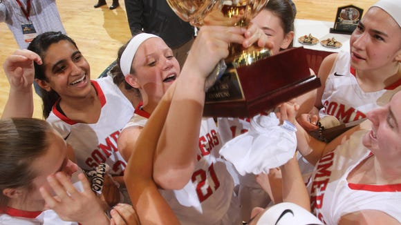 Somers players celebrate with the gold ball after defeating