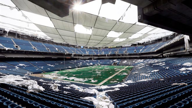 "In this May 12, 2014, file photo, the interior of the Pontiac Silverdome, former home of the NFL football Detroit Lions, is seen in Pontiac, Mich. The Michigan Senate passed legislation that would ease some of the financial burden of cleaning up brownfield sites for redevelopment. Sen. Ken Horn, R-Frankenmuth, introduced the package of bills that he said would help redevelop sites that have sat dormant for many years into mixed-use projects. Pontiac Mayor Deidre Waterman also supports the legislation that could help redevelop the Silverdome, or as Waterman called it, the ""world's largest bird bath."" (AP Photo/Carlos Osorio, File)"