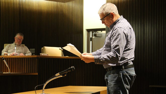 """J.R. Rice, manager of Mansfield's codes and permits department, reads from the proposed """"chicken bill"""" at a zoning committee meeting Monday, March 6, 2017. The proposed bill would allow residents to keep chickens on properties smaller than 3 acres."""