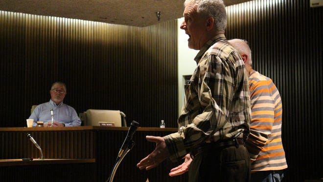 Dennis Rohwer speaks to Mansfield City Council about his concerns over the city's pit bull problem during a council meeting Tuesday, March 7, 2017.  Rohwer spoke to council with his wife, Hettie (not pictured), about their two dogs, one of which was injured and the other killed during a pit bull attack. Roger Ott (pictured, right), whose dog was killed during the same attack, also spoke to council.