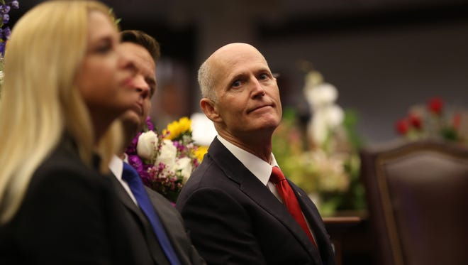 Gov. Rick Scott listens in as legislators gather for the first day of session at the Capitol on Tuesday, March 7, 2017.