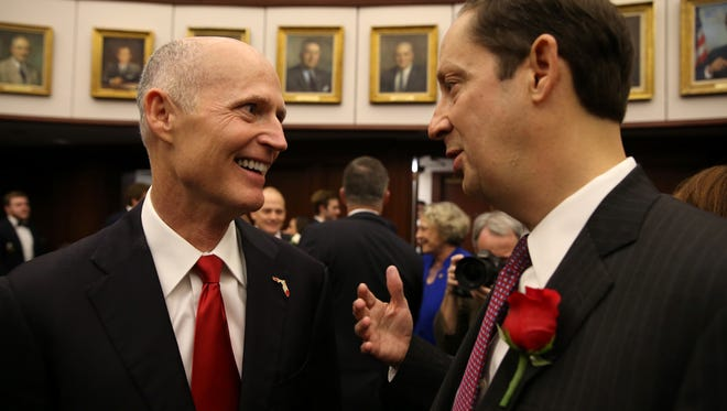 Gov. Rick Scott meets with Senate President Joe Negron on the first day of the legislative session at the Capitol on Tuesday, March 7, 2017.