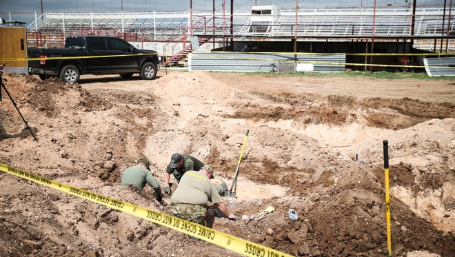 A Tom Green County Sheriff's Office crew uncovers the body of Naomi Michelle Miller on March 8, 2017, at the former San Angelo Speedway on Farm-to-Market Road 2105.