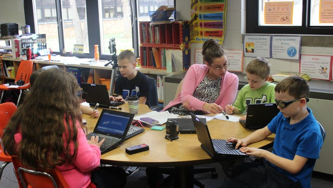 Andrea Spall works with her students at Fair Lawn Elementary School.