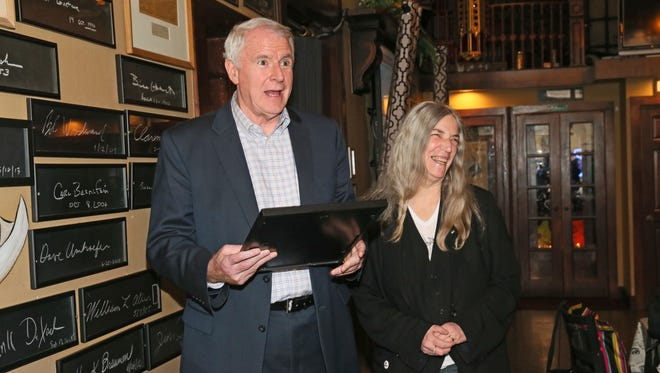 Mayor Tom Barrett presents Patti Smith with a proclamation declaring it Patti Smith Day in Milwaukee as the singer and author visits the Milwaukee Press Club's Newsroom Pub, 137 E. Wells St.