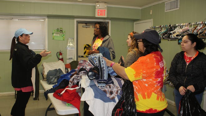 Centenary College of Louisiana Students help sort clothes and hangers at Common Ground Community, Inc.