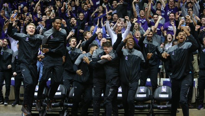 The Northwestern men's basketball team and fans celebrate upon learning the Wildcats had made the NCAA tournament.