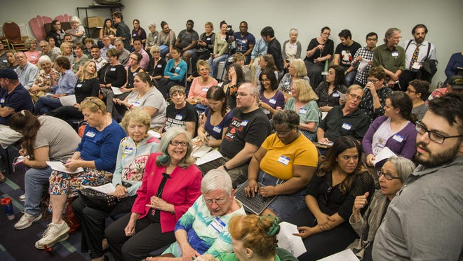 It was standing-room only as the Arizona Democratic Party meeting started March 9, 2017, in Phoenix. Political engagement in both major parties has grown since the election of Donald Trump.