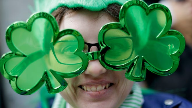 Caitlin Neal-Karhut, of Seaford, N.Y., smiles as she watches the St. Patrick's Day Parade, Tuesday, March 17, 2015, in New York.