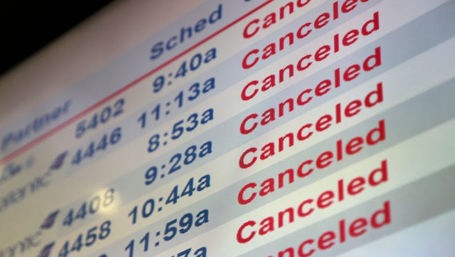 Screens display canceled flights at Newark Liberty International Airport on Tuesday, March 14, 2017.