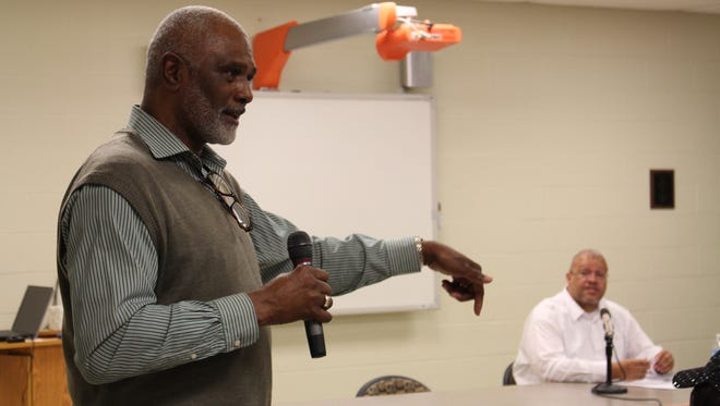 Geron Tate, president of the Mansfield branch of the NAACP, speaks during a town hall meeting about race and diversity at Mansfield Senior High School on Thursday, March 16, 2017. Mansfield native James Jones, an associate professor of history at Texas' Prairie View A&M University who facilitated the discussion, sits in the background.