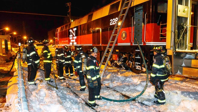 City firefighters at a train fire near the Poughkeepsie train station Wednesday evening.
