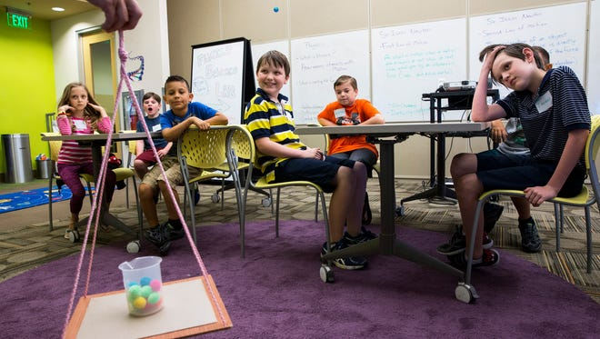 Audrey Messina, 9, from left, Adam Pennington-Aten, 10, Jonathon Gonzalez, 6, Hunter Lund, 11, Matthew Nisbett, 11, and Thomas Lund, 11, watch as their instructor demonstrates centripetal force during the Homeschool: Funky Physics class at the Golisano ChildrenÕs Museum of Naples on Tuesday, March 21, 2017. Homeschool classes happen on a monthly basis every Tuesday of the month with age/grade specific classes for all ranges of learners.