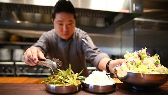 Executive chef Hyunwook Lee prepares Banchan (assortment of vegetable dishes given with meal) at Sizzle Korean BBQ on March 20, 2017  at Desert Ridge Marketplace in Phoenix.