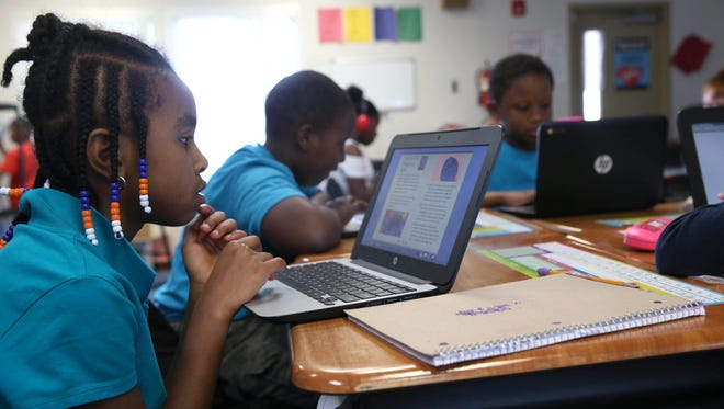 Faith Steen looks over a lesson plan on her computer in teacher Nicole Roddenberry's 3rd grade class at the Jefferson County Elementary School in February.