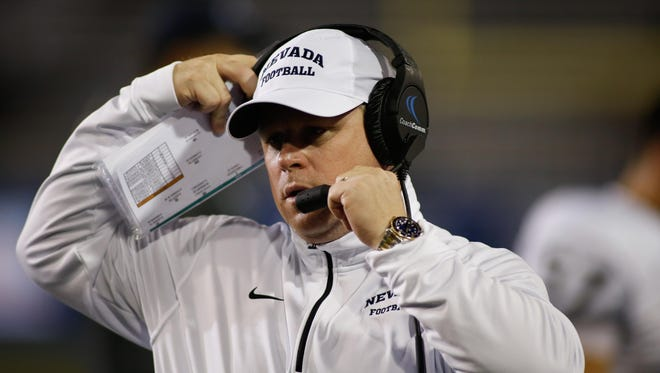 Oct 15, 2016; San Jose, CA, USA;  Nevada Wolf Pack head coach Brian Polian adjust his headset during a game against the San Jose State Spartans in the 2nd quarter at Spartan Stadium. Mandatory Credit: Stan Szeto-USA TODAY Sports