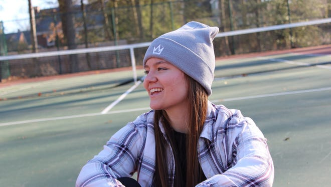 Danielle Regina, of Pompton Lakes, models one of the hats for QWN Apparel, a company she recently began out of her dorm room.